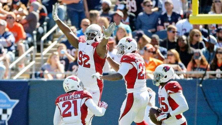 CHICAGO, IL - SEPTEMBER 20: Tony Jefferson #22 of the Arizona Cardinals celebrates with Frostee Rucker #92 and Patrick Peterson #21 after making an interception for a touchdown against the Chicago Bears during the second quarter at Soldier Field on September 20, 2015 in Chicago, Illinois. (Photo by Jon Durr/Getty Images)