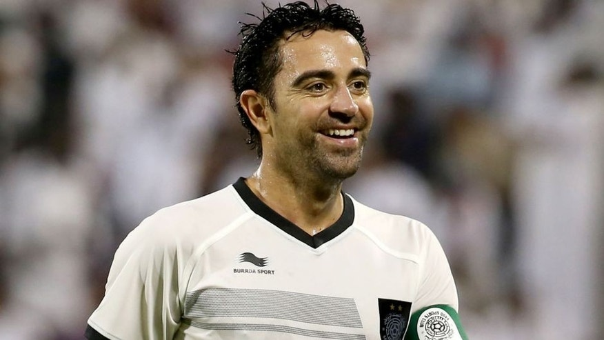Barcelona football legend Xavi Hernandez who recently signed with Qatar's Al-Sadd club smiles during their Qatar Stars League football match against Al-Mesaimeer in Doha on September 13, 2015. AFP PHOTO / AL-WATAN DOHA / KARIM JAAFAR == QATAR OUT == (Photo credit should read KARIM JAAFAR/AFP/Getty Images)
