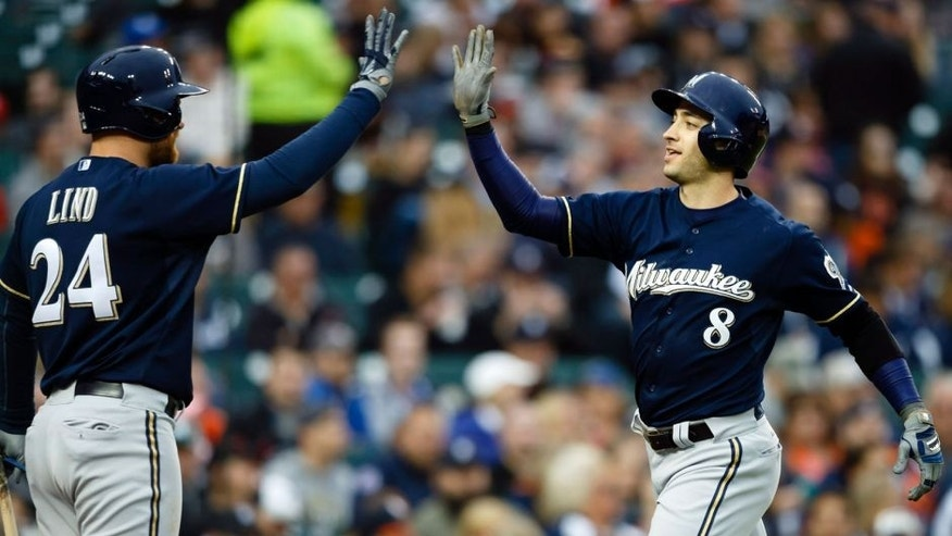 <p>May 20, 2015; Detroit, MI, USA; Milwaukee Brewers designated hitter Ryan Braun (8) receives congratulations from first baseman Adam Lind (24) after he hit a home run in the fourth inning against the Detroit Tigers at Comerica Park. Mandatory Credit: Rick Osentoski-USA TODAY Sports</p>