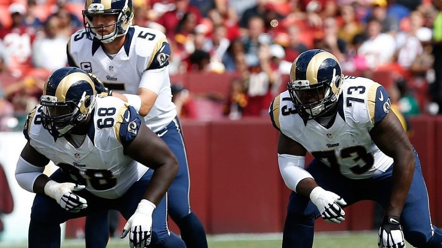 Sep 20, 2015; Landover, MD, USA; St. Louis Rams offensive guard Jamon Brown (68) and Rams tackle Greg Robinson (73) line up against the Washington Redskins at FedEx Field. Mandatory Credit: Geoff Burke-USA TODAY Sports