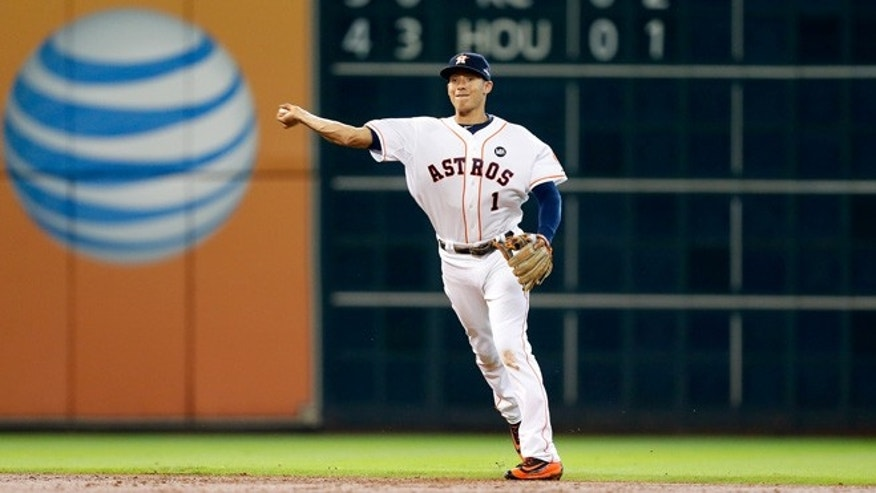 HOUSTON, TX - OCTOBER 12: Carlos Correa #1 of the Houston Astros fields a ground ball in the third inning against the Kansas City Royals during game four of the American League Divison Series at Minute Maid Park on October 12, 2015 in Houston, Texas.  (Photo by Bob Levey/Getty Images)