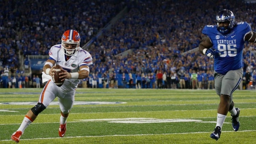 Sep 19, 2015; Lexington, KY, USA; Florida Gators quarterback Will Grier (7) runs for a touchdown against the Kentucky Wildcats in the first quarter at Commonwealth Stadium. Mandatory Credit: Mark Zerof-USA TODAY Sports