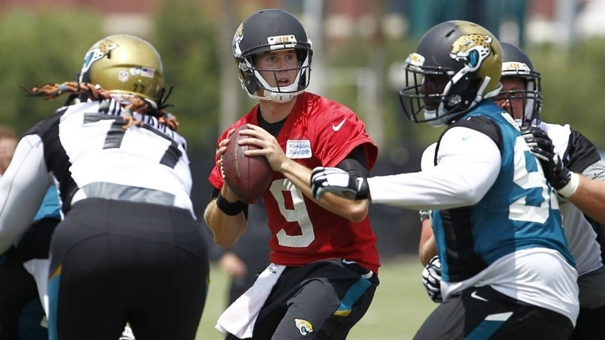 <p>Jul 31, 2015; Jacksonville, FL, USA; Jacksonville Jaguars quarterback Jeff Tuel (9) drops to throw under pressure during training camp workouts at Florida Blue Health & Wellness Practice Field. Mandatory Credit: Reinhold Matay-USA TODAY Sports</p>