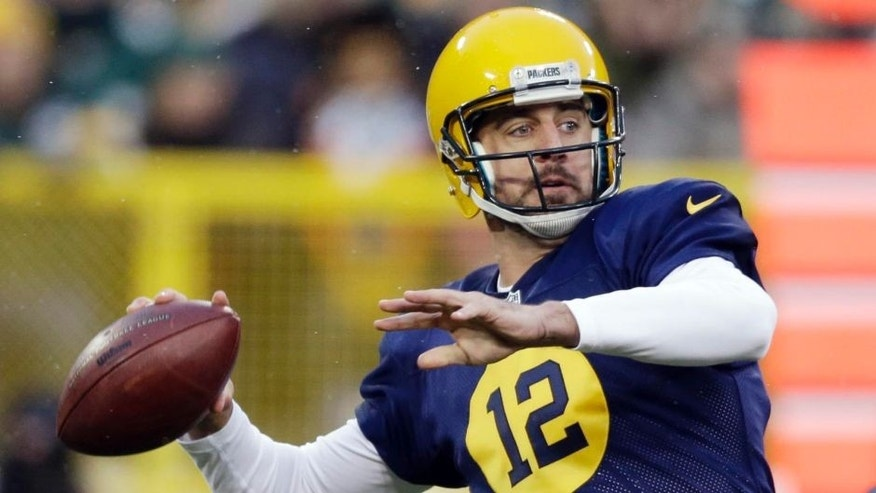 The Green Bay Packers' Aaron Rodgers throws during the first half against the Philadelphia Eagles in Green Bay, Wis.