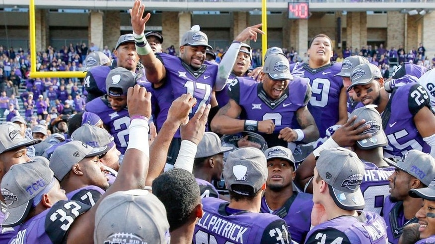 Dec 6, 2014; Fort Worth, TX, USA; TCU Horned Frogs quarterback Trevone Boykin (2) and safety Sam Carter (17) and teammates celebrate after the victory against the Iowa State Cyclones at Amon G. Carter Stadium. Mandatory Credit: Kevin Jairaj-USA TODAY Sports
