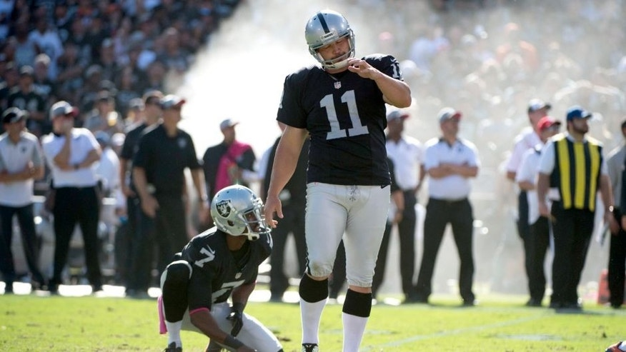 October 11, 2015; Oakland, CA, USA; Oakland Raiders kicker Sebastian Janikowski (11) reacts after missing a field goal from the hold by punter Marquette King (7) during the fourth quarter against the Denver Broncos at O.co Coliseum. The Raiders defeated the Broncos 16-10. Mandatory Credit: Kyle Terada-USA TODAY Sports