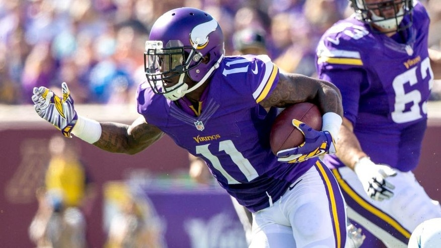 Sep 27, 2015; Minneapolis, MN, USA; Minnesota Vikings wide receiver Mike Wallace (11) carries the ball during the third quarter against the San Diego Chargers at TCF Bank Stadium. The Vikings defeated the Chargers 31-14. Mandatory Credit: Brace Hemmelgarn-USA TODAY Sports