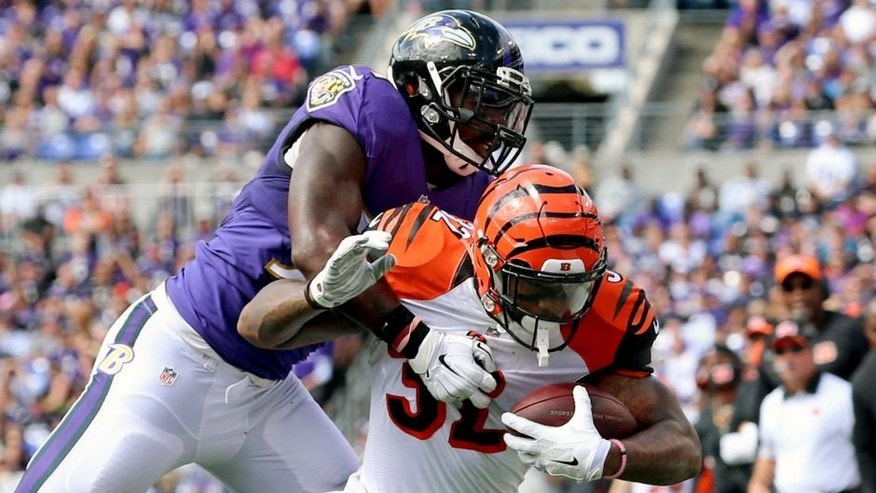 Sep 27, 2015; Baltimore, MD, USA; Cincinnati Bengals running back Jeremy Hill (32) tackled by Baltimore Ravens linebacker C.J. Mosley (57) at M&T Bank Stadium. Mandatory Credit: Mitch Stringer-USA TODAY Sports