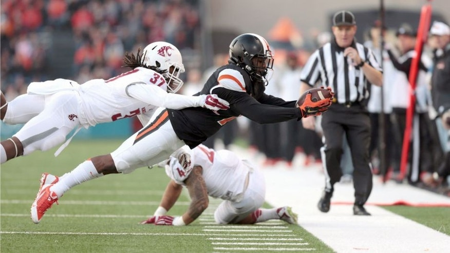 Nov 8, 2014; Corvallis, OR, USA; Washington State Cougars safety Sulaiman Hameed (37) tackles Oregon State Beavers wide receiver Hunter Jarmon (7) at Reser Stadium. Mandatory Credit: Scott Olmos-USA TODAY Sports