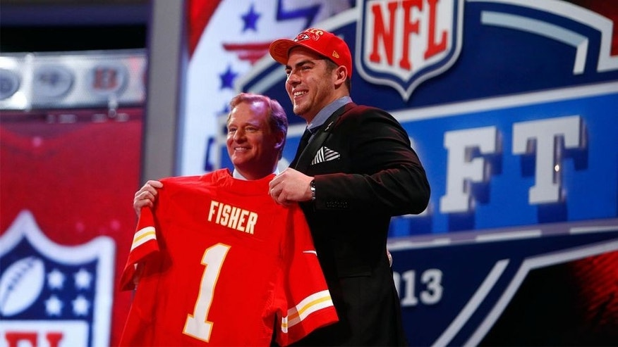 Apr 25, 2013; New York, NY, USA; NFL commissioner Roger Goodell (left) introduces Eric Fisher (Central Michigan) as the number one overall pick to the Kansas City Chiefs during the 2013 NFL Draft at Radio City Music Hall. Mandatory Credit: Jerry Lai-USA TODAY Sports