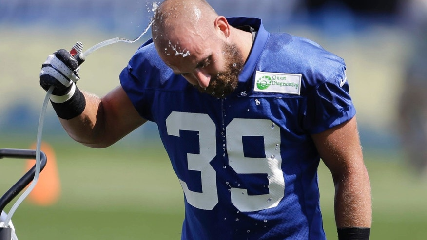 FILE - In this Saturday, July 27, 2013, file photo, New York Giants safety Tyler Sash cools off at a water fountain during NFL football training camp in East Rutherford, N.J.