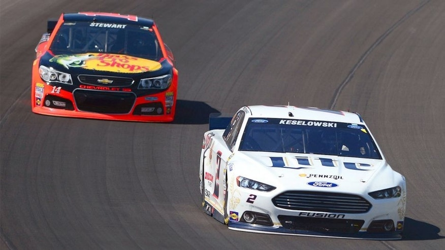 Jun 15, 2014; Brooklyn, MI, USA; NASCAR Sprint Cup Series driver Brad Keselowski leads Tony Stewart during the Quicken Loans 400 at Michigan International Speedway. Mandatory Credit: Andrew Weber-USA TODAY Sports