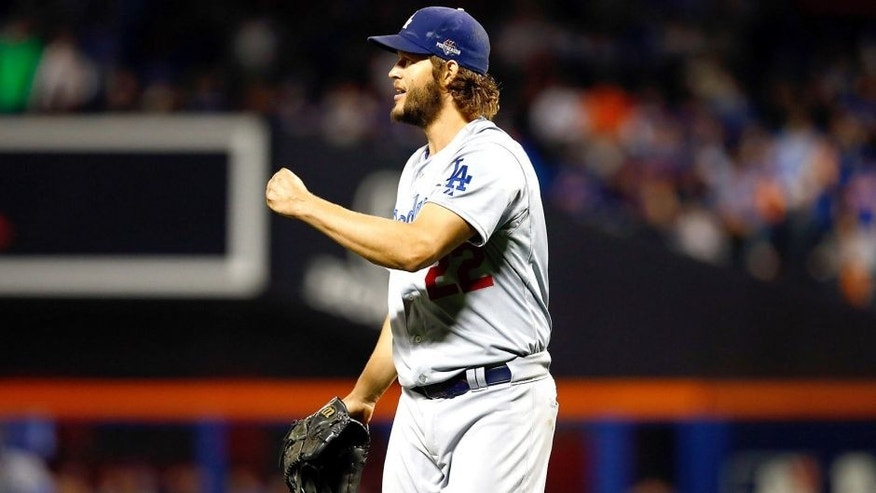 NEW YORK, NY - OCTOBER 13: Clayton Kershaw #22 of the Los Angeles Dodgers react after closing out the seventh inning against the New York Mets during game four of the National League Division Series at Citi Field on October 13, 2015 in New York City. (Photo by Mike Stobe/Getty Images)