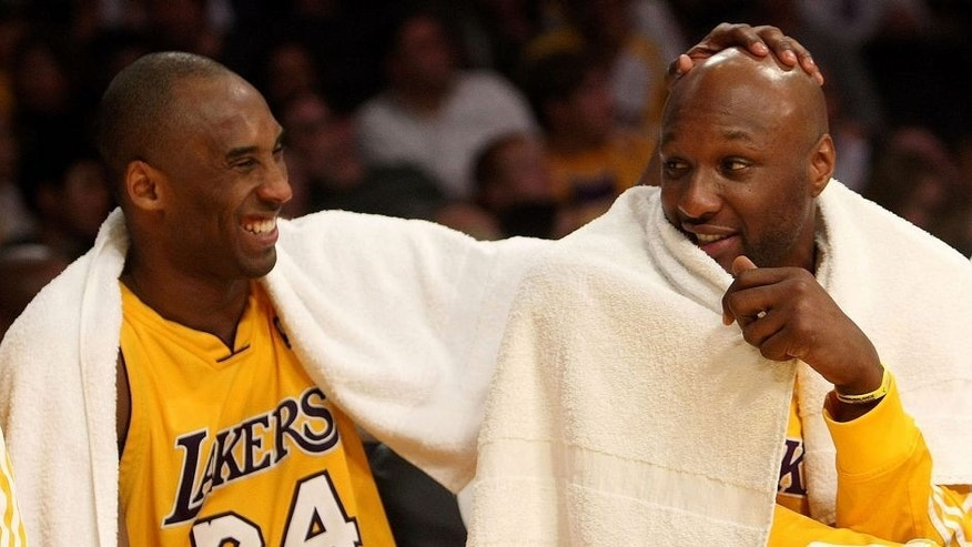 <p>LOS ANGELES, CA - JANUARY 15: (L-R) Kobe Bryant #24 and Lamar Odom #7 of the Los Angeles Lakers share a laugh on the bench during the game against the Los Angeles Clippers on January 15, 2010 at Staples Center in Los Angeles, California. The Lakers won 126-86. NOTE TO USER: User expressly acknowledges and agrees that, by downloading and/or using this Photograph, user is consenting to the terms and conditions of the Getty Images License Agreement. (Photo by Stephen Dunn/Getty Images)</p>