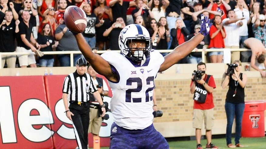 LUBBOCK, TX - SEPTEMBER 26: Aaron Green #22 of the TCU Horned Frogs catches a tipped ball in the end zone for the game winning touchdown late in the 4th quarter against the Texas Tech Red Raiders on September 26, 2015 at Jones AT&T Stadium in Lubbock, Texas. TCU won the game 55-52. (Photo by John Weast/Getty Images)