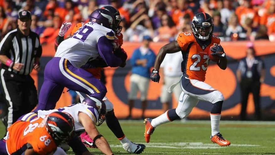 Denver Broncos running back Ronnie Hillman runs for a touchdown during the first half against the Minnesota Vikings at Sports Authority Field at Mile High in Denver on Sunday, Oct. 4, 2015.