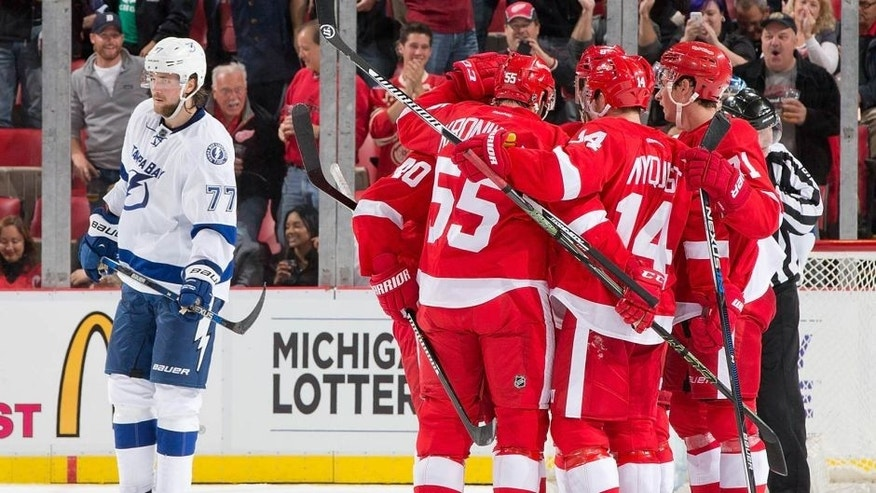 DETROIT, MI - OCTOBER 13: Gustav Nyquist #14 of the Detroit Red Wings celebrates his second period goal with teammates Niklas Kronwall #55, Gustav Nyquist #14, Henrik Zetterberg #40 and Dylan Larkin #71 during an NHL game against the Tampa Bay Lightning at Joe Louis Arena on October 13, 2015 in Detroit, Michigan. (Photo by Dave Reginek/NHLI via Getty Images)