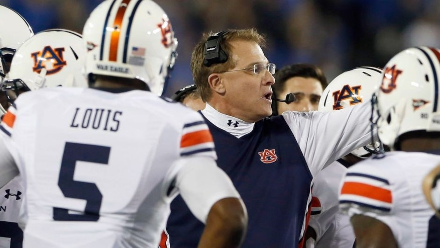 Oct 15, 2015; Lexington, KY, USA; Auburn Tigers head coach Gus Malzahn coaches his team against the Kentucky Wildcats in the first quarter at Commonwealth Stadium. Mandatory Credit: Mark Zerof-USA TODAY Sports