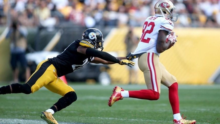 Sep 20, 2015; Pittsburgh, PA, USA; San Francisco 49ers wide receiver Torrey Smith (82) carries the ball away from Pittsburgh Steelers strong safety Will Allen (20) on a seventy-five yard touchdown catch during the fourth quarter at Heinz Field. The Steelers won 43-18. Mandatory Credit: Charles LeClaire-USA TODAY Sports