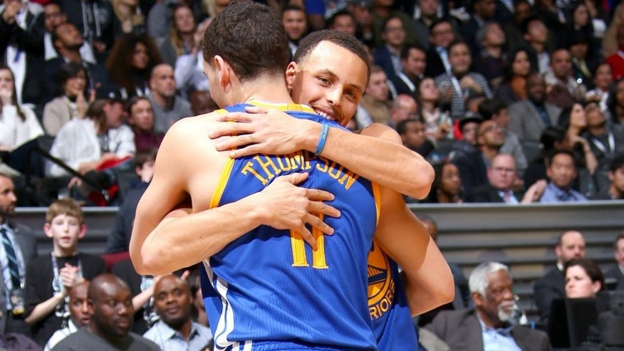 BROOKLYN, NY - FEBRUARY 14: Teammates Stephen Curry #30 and Klay Thompson #11 of the Golden State Warriors hug during the Foot Locker Three Point Contest on State Farm All-Star Saturday Night as part of the 2015 NBA All-Star Weekend on February 14, 2015 at Barclays Center in Brooklyn, New York. NOTE TO USER: User expressly acknowledges and agrees that, by downloading and/or using this photograph, user is consenting to the terms and conditions of the Getty Images License Agreement. Mandatory Copyright Notice: Copyright 2015 NBAE (Photo by Nathaniel S. Butler/NBAE via Getty Images)