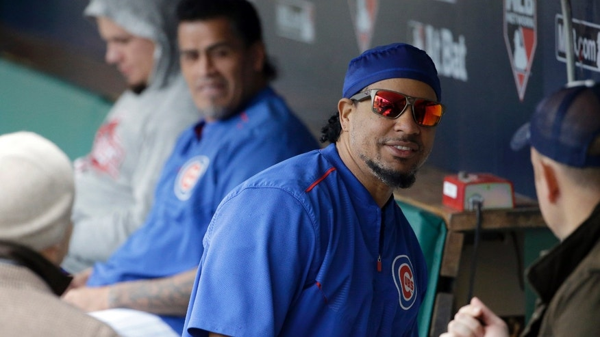 In this Tuesday, Oct. 13, 2015, photo, Manny Ramirez talks to reporters in the dugout before Game 4 in baseball's National League Division Series between the Chicago Cubs and the St. Louis Cardinals in Chicago. Ramirez isn't listed on either the coaching or support staffs as Chicago heads into the NL Championship Series. Yet nearly every hitter on the roster checks in with him regularly and the team's young Latin players--budding stars Jorge Soler and Javier Baez, in particular--also revere him as some kind of life coach or guru. (AP Photo/Nam Y. Huh)