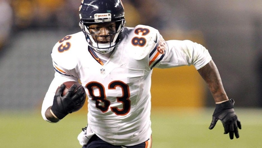 Sep 22, 2013; Pittsburgh, PA, USA; Chicago Bears tight end Martellus Bennett (83) runs after a pass reception against the Pittsburgh Steelers during the fourth quarter at Heinz Field. The Bears won 40-23. Mandatory Credit: Charles LeClaire-USA TODAY Sports