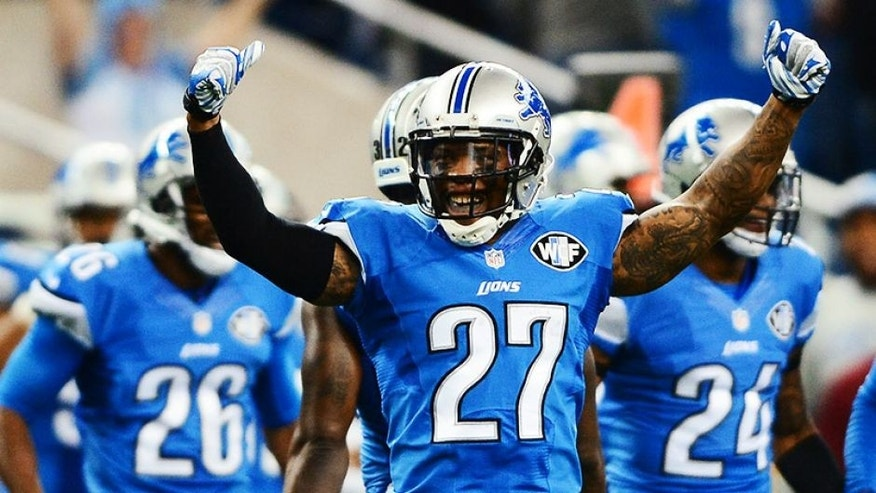 Oct 19, 2014; Detroit, MI, USA; Detroit Lions free safety Glover Quin (27) celebrates after defeating the New Orleans Saints 24-23 at Ford Field. Mandatory Credit: Andrew Weber-USA TODAY Sports