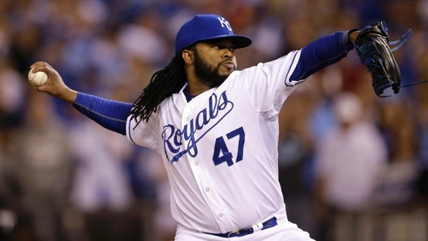 Kansas City Royals starting pitcher Johnny Cueto throws a pitch during the first inning of Game 5 in baseball's American League Division Series against the Houston Astros, Wednesday, Oct. 14, 2015, in Kansas City, Mo. (AP Photo/Orlin Wagner)