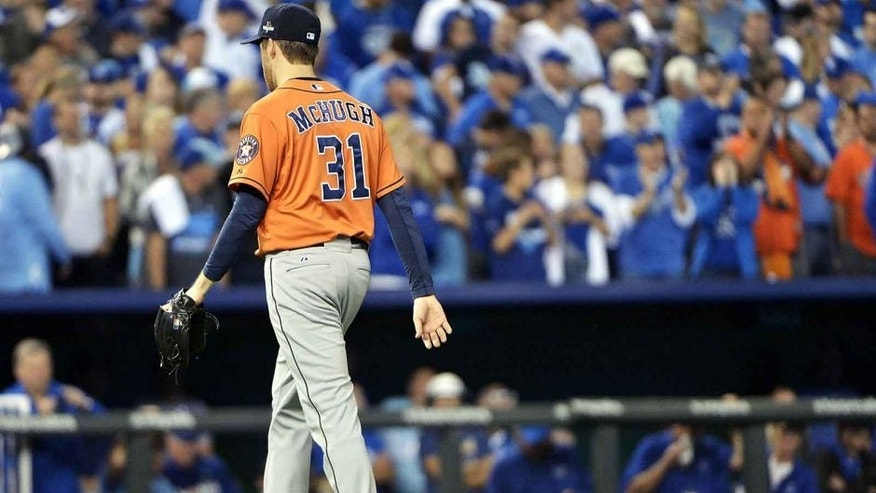 Oct 14, 2015; Kansas City, MO, USA; Houston Astros starting pitcher Collin McHugh (31) walks to the dugout after being relived against the Kansas City Royals in the fifth inning in game five of the ALDS at Kauffman Stadium. Mandatory Credit: Denny Medley-USA TODAY Sports
