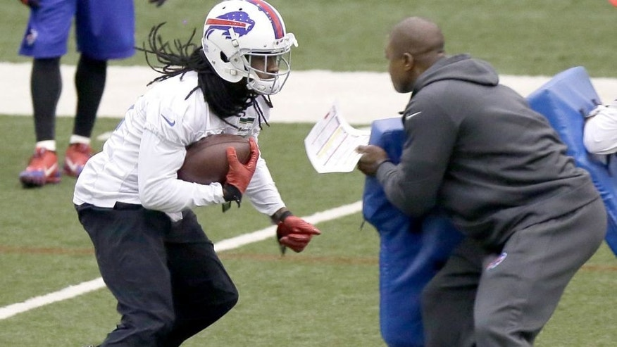Buffalo Bills wide receiver Sammy Watkins, left, runs a drill during practice at the Detroit Lions' indoor NFL football training facility in Allen Park, Mich., Saturday, Nov. 22, 2014. The Bills are using the facility in preparation for Monday's game against the Jets, which was moved to Detroit because of the snowstorm in Buffalo. (AP Photo/Duane Burleson)