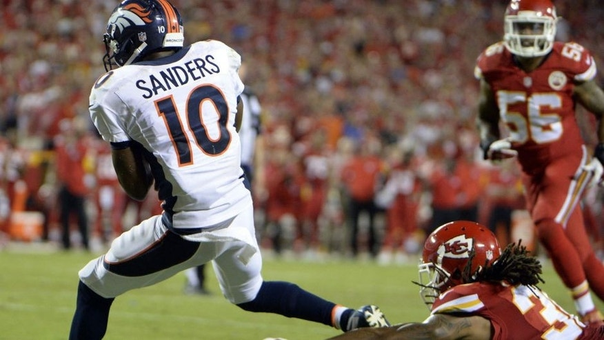 Sep 17, 2015; Kansas City, MO, USA; Denver Broncos wide receiver Emmanuel Sanders (10) catches a touchdown against the Kansas City Chiefs in the second half at Arrowhead Stadium. Denver won the game 31-24. Mandatory Credit: John Rieger-USA TODAY Sports