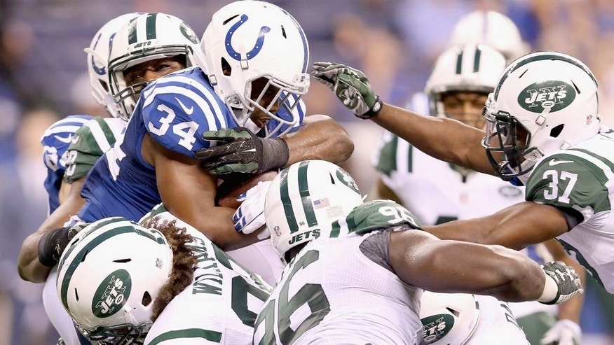 INDIANAPOLIS, IN - SEPTEMBER 21: Josh Robinson #34 of the Indianapolis Colts is tackled by the New York Jets defense during the game at Lucas Oil Stadium on September 21, 2015 in Indianapolis, Indiana. (Photo by Andy Lyons/Getty Images)