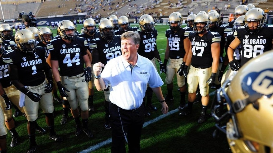 Sep 7, 2013; Boulder, CO, USA; Colorado Buffaloes head coach Mike Macintyre huddles with members of his team before the game against the Central Arkansas Bears at Folsom Field. Mandatory Credit: Ron Chenoy-USA TODAY Sports