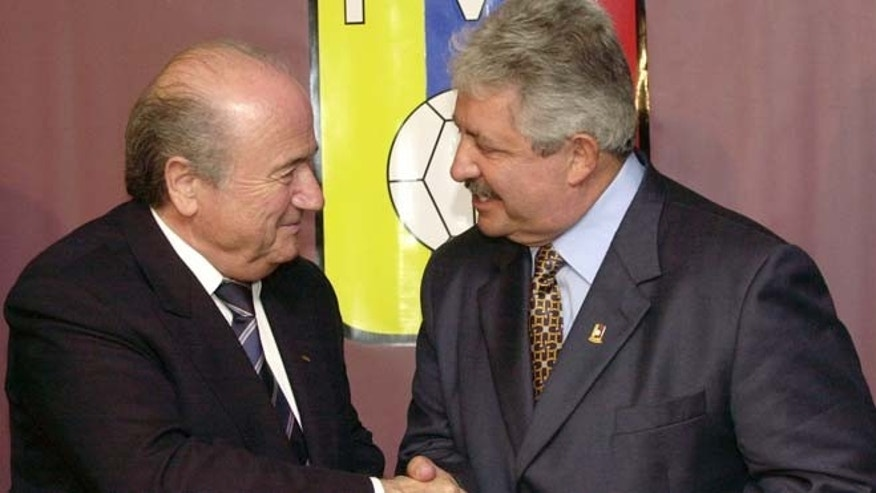 FILE - In this Nov. 8, 2004 file photo Sepp Blatter, President of the FIFA, left, shakes hands with the President of the Venezuelan Soccer Federation, Rafael Esquivel, in Caracas, Venezuela. Switzerlandâs justice ministry granted a U.S. request to extradite Venezuelan football official Rafael Esquivel in a FIFA bribery investigation. Esquivel is âaccused of receiving bribes worth millions of dollars in connection with the sale of marketing rights to the Copa America tournaments in 2007, 2015, 2016, 2019 and 2023,â the Swiss ministry said in a statement on Wednesday, Sept. 23, 2015.  (AP Photo/Leslie Mazoch)