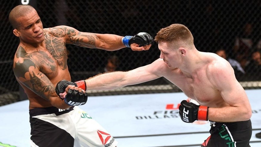 GLASGOW, SCOTLAND - JULY 18: (R-L) Joe Duffy of Ireland punches Ivan Jorge of Brazil in their lightweight fight during the UFC Fight Night event inside the SSE Hydro on July 18, 2015 in Glasgow, Scotland. (Photo by Josh Hedges/Zuffa LLC/Zuffa LLC via Getty Images)
