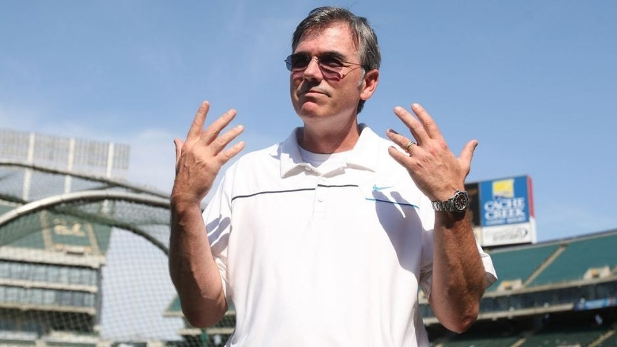 OAKLAND, CA - JULY 3: General Manager Billy Beane of the Oakland Athletics stands on the field prior to the game against the Chicago Cubs at O.co Coliseum on July 3, 2013 in Oakland, California. The Cubs defeated the Athletics 3-1. (Photo by Michael Zagaris/Oakland Athletics/Getty Images) *** Local Caption *** Billy Beane