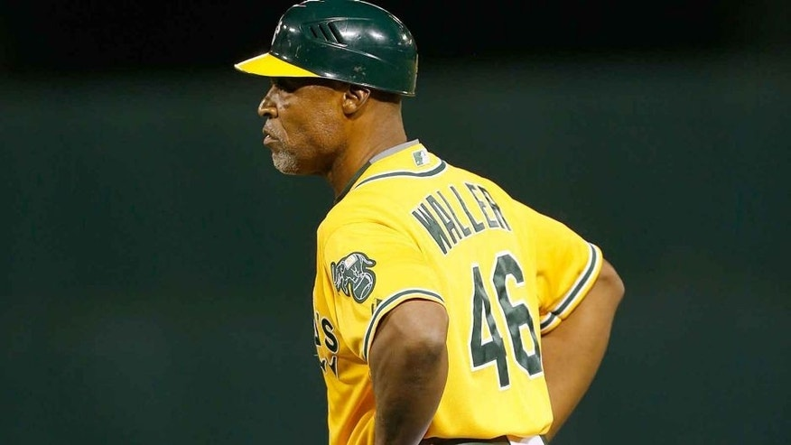 OAKLAND, CA - SEPTEMBER 9: First Base Coach Tye Waller #46 of the Oakland Athletics stands at first during the game against the Houston Astros at O.co Coliseum on September 9, 2015 in Oakland, California. The Astros defeated the Athletics 11-5. (Photo by Michael Zagaris/Oakland Athletics/Getty Images)