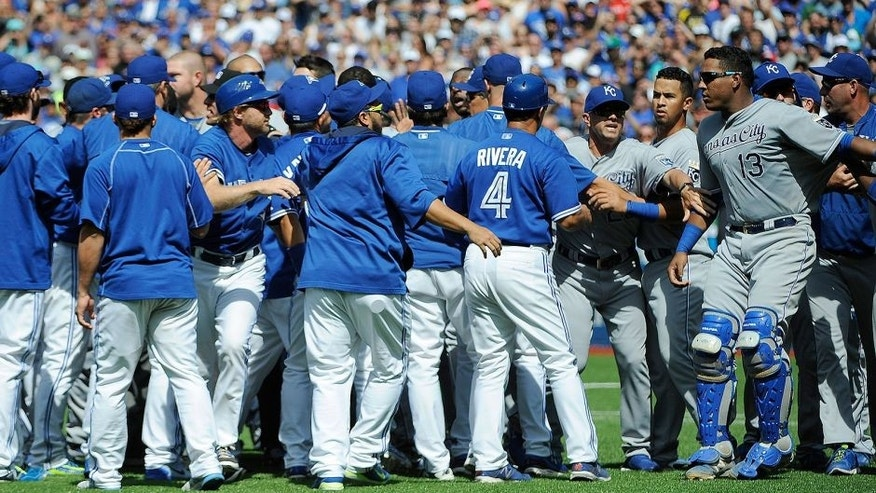 Aug 2, 2015; Toronto, Ontario, CAN; Toronto Blue Jays and Kansas City Royals players confrontation after relief pitcher Aaron Sanchez (41) pitches and hits Kansas City Royals short stop Alcides Escobar (2) (not in picture) and gets ejected by home plate umpire Jim Wolf in the eighth inning at Rogers Centre. Blue Jays beat Royals 5 - 2. Mandatory Credit: Peter Llewellyn-USA TODAY Sports