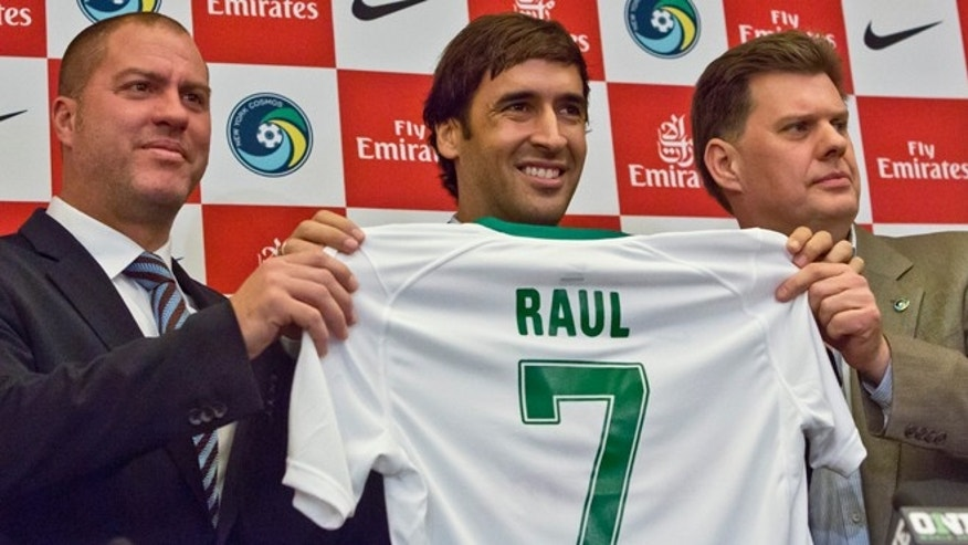 In this Dec. 9, 2014 file photo, New York Cosmos soccer coach Giovanni Savanese, left, and team chairman Seamus O'Brien, right, pose with Spain's former national team captain and former Real Madrid star Raúl Gonzalez Blanco, after his introduction as the team's newest member in New York. Gonzalez Blanco, popularly known as Raúl, announced on Thursday, Oct. 15, 2015 that he'll retire from active football at the end of the season the North American Soccer League (NASL) in November.  (AP Photo/Bebeto Matthews, File)