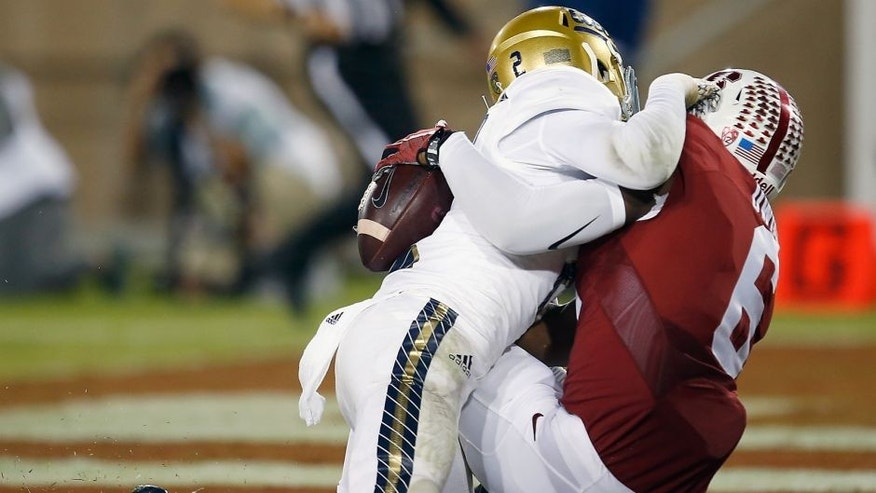 Stanford wide receiver Francis Owusu, right, catches a touchdown pass behind the back of UCLA defensive back Jaleel Wadood during the second half of an NCAA college football game Thursday, Oct. 15, 2015, Stanford, Calif. (AP Photo/Tony Avelar)