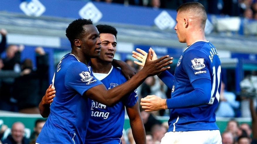 LIVERPOOL, ENGLAND - OCTOBER 04: Romelu Lukaku (L) of Everton celebrates with Tyias Browning (C) of Everton and Ross Barkley (R) of Everton after scoring Everton's first goal during the Barclays Premier League match between Everton and Liverpool at Goodison Park on October 4, 2015 in Liverpool, England. (Photo by Dean Mouhtaropoulos/Getty Images)