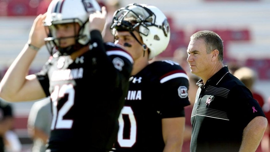 COLUMBIA, SC - OCTOBER 17: Interim head coach Shawn Elliott of the South Carolina Gamecocks watches on as quarterbacks Michael Scarnecchia #12 and Perry Orth #10 of the South Carolina Gamecocks warm up before their game against the Vanderbilt Commodores at Williams-Brice Stadium on October 17, 2015 in Columbia, South Carolina. (Photo by Streeter Lecka/Getty Images)