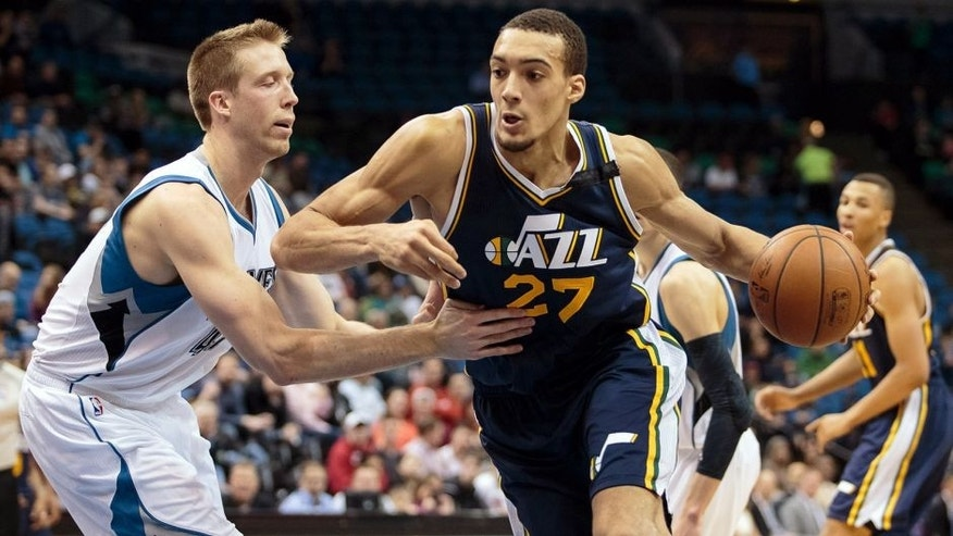 Mar 30, 2015; Minneapolis, MN, USA; Utah Jazz center Rudy Gobert (27) dribbles in the fourth quarter against Minnesota Timberwolves center Justin Hamilton (41) at Target Center. The Utah Jazz beat the Minnesota Timberwolves 104-84. Mandatory Credit: Brad Rempel-USA TODAY Sports