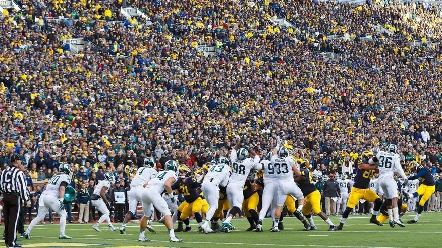 Oct 17, 2015; Ann Arbor, MI, USA; Michigan Wolverines place kicker Kenny Allen (91) kicks a field goal in the third quarter against the Michigan State Spartans at Michigan Stadium. Mandatory Credit: Rick Osentoski-USA TODAY Sports