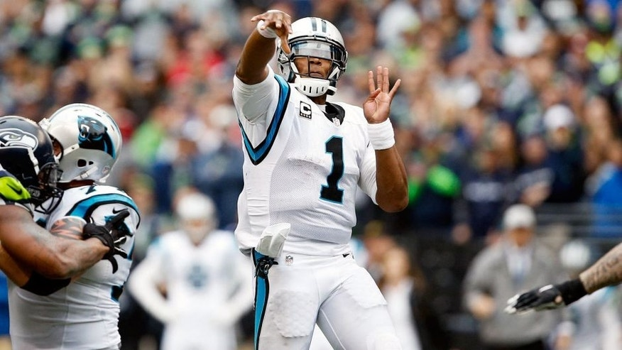 Oct 18, 2015; Seattle, WA, USA; Carolina Panthers quarterback Cam Newton (1) throws a 26-yard touchdown pass against the Seattle Seahawks during the fourth quarter at CenturyLink Field. Carolina defeated Seattle, 27-23. Mandatory Credit: Joe Nicholson-USA TODAY Sports