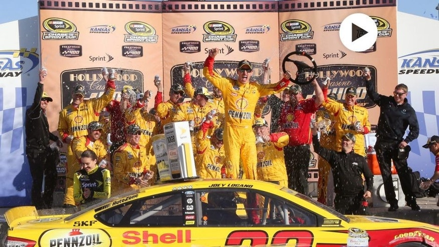 Joey Logano, driver of the #22 Shell Pennzoil Ford, celebrates in Victory Lane after winning the NASCAR Sprint Cup Series Hollywood Casino 400 at Kansas Speedway on October 18, 2015 in Kansas City, Kansas. (Photo by Jerry Markland/Getty Images)