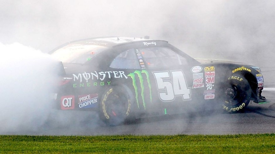 KANSAS CITY, KS - OCTOBER 17: Kyle Busch, driver of the #54 Monster Energy Toyota, celebrates with a burnout after winning the NASCAR XFINITY Series Kansas Lottery 300 at Kansas Speedway on October 17, 2015 in Kansas City, Kansas. (Photo by Robert Laberge/NASCAR via Getty Images)