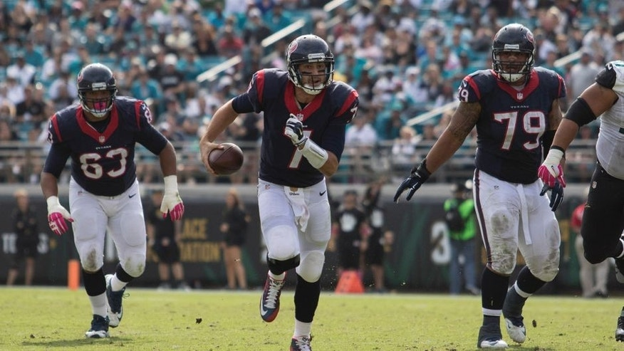 Oct 18, 2015; Jacksonville, FL, USA; Houston Texans quarterback Brian Hoyer (7) runs for a first down in the fourth quarter against the Jacksonville Jaguars at EverBank Field. The Houston Texans won 31-20. Mandatory Credit: Logan Bowles-USA TODAY Sports