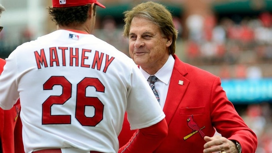 ST. LOUIS, MO - APRIL 13: Former St. Louis Cardinals manager Tony La Russa greets manager Mike Matheny #26 before a game against the Milwaukee Brewers at Busch Stadium on April 13, 2015 in St. Louis, Missouri. (Photo by Jeff Curry/Getty Images)