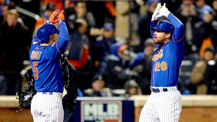 NEW YORK, NY - OCTOBER 18: Daniel Murphy #28 of the New York Mets celebrates with David Wright #5 after hitting a two run home run in the first inning against Jake Arrieta #49 of the Chicago Cubs during game two of the 2015 MLB National League Championship Series at Citi Field on October 18, 2015 in the Flushing neighborhood of the Queens borough of New York City. (Photo by Elsa/Getty Images)